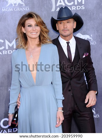 LOS ANGELES - APR 06:  Faith Hill & Tim McGraw arrives to the 49th Annual Academy of Country Music Awards   on April 06, 2014 in Las Vegas, NV.                 - stock photo