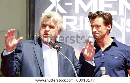LOS ANGELES - APR 21: Hugh Jackman and Jay Leno at the ceremony for Hugh Jackman who is honored with a hand and footprint ceremony in  Los Angeles, California on April 21, 2009 - stock photo