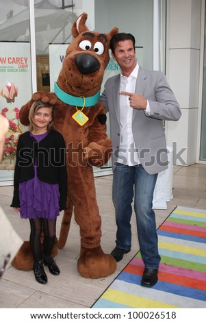 "LOS ANGELES - APR 12:  Isabella Lamas, Scooby-Doo, Lorenzo Lamas arrives at Warner Brothers ""Television: Out of the Box"" Exhibit Launch at Paley Center for Media on April 12, 2012 in Beverly Hills, CA - stock photo"