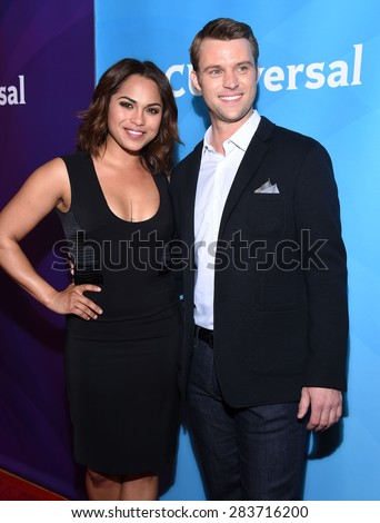 LOS ANGELES - APR 02:  Monica Raymund & Jesse Spencer arrives to the NBCUniversal's Summer Press Day 2015  on April 02, 2015 in Hollywood, CA                 - stock photo