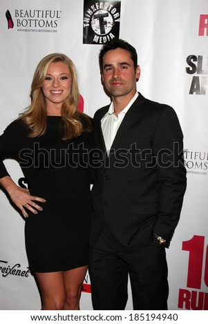 "LOS ANGELES - APR 1:  Nikki Leigh, Jesse Bradford at the ""10 Rules for Sleeping Around"" Premiere at Egyptian Theater on April 1, 2014 in Los Angeles, CA"