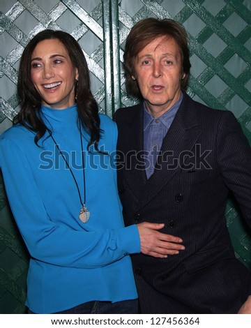 """LOS ANGELES - APR 13:  PAUL McCARTNEY & NANCY arriving to """"My Valentine"""" World Premiere  on April 13, 2012 in Beverly Hills, CA - stock photo"""