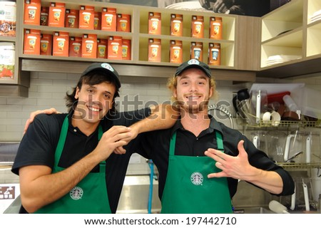 LOS ANGELES - APRIL 14: barmen in Starbucks Cafe on April 14, 2011 in Los Angeles, USA. Starbucks is the largest coffeehouse company in the world, with 23,187 stores - stock photo