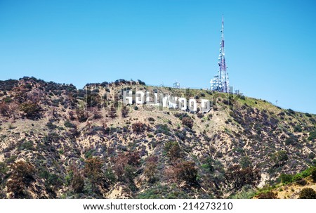 LOS ANGELES - APRIL 22: Hollywood sign located on Mount Lee on April 22, 2014 in Los Angeles, California. It's a landmark and American cultural icon located on Mount Lee in the Hollywood Hills area. - stock photo