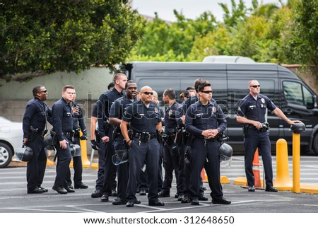 LOS ANGELES - APRIL 24: Los Angeles police officers group on April 24, 2015 in Los Angeles - stock photo