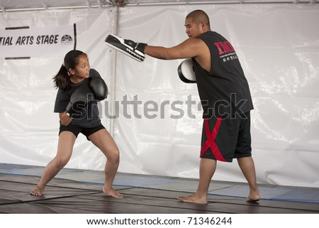 LOS ANGELES - APRIL 5:  Members of Torrance's IMB Academy demonstrate boxing at the Little Tokyo Cherry Blossom Festival on April 5th, 2009 in Los Angeles. - stock photo