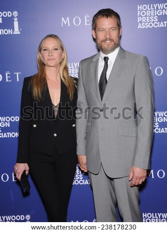 LOS ANGELES - AUG 14:  Anne Heche & James Tupper arrives to the HFPA Annual Installation Dinner 2014 on August 14, 2014 in Beverly Hills, CA                 - stock photo