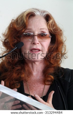 LOS ANGELES - AUG 27:  Bonnie Raitt at the Joe Smith Star on the Hollywood Walk of Fame at the Capital Records Building on August 27, 2015 in Los Angeles, CA - stock photo