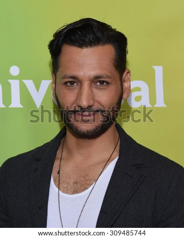 LOS ANGELES - AUG 12:  Cas Anvar arrives to the arrives to the Summer 2015 TCA's - NBCUniversal  on August 12, 2015 in Beverly Hills, CA                 - stock photo