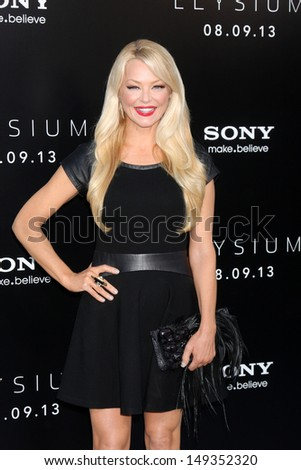 "LOS ANGELES - AUG 7:  Charlotte Ross arrives at the ""Elysium"" World Premiere at the Village Theater on August 7, 2013 in Westwood, CA"