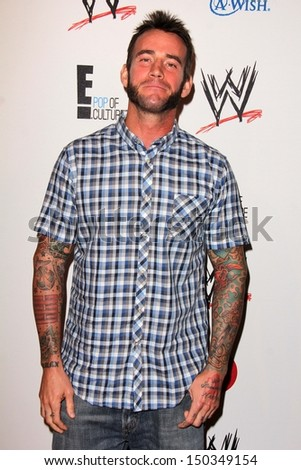 LOS ANGELES - AUG 15:  CM Punk at the Superstars for Hope honoring Make-A-Wish at the Beverly Hills Hotel on August 15, 2013 in Beverly Hills, CA - stock photo