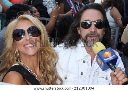 LOS ANGELES - AUG 21:  Cristian Solis, Marco Antonio Solis at the Los Tigres Del Norte Honored On The Hollywood Walk Of Fame at Live Nation Building on August 21, 2014 in Los Angeles, CA - stock photo