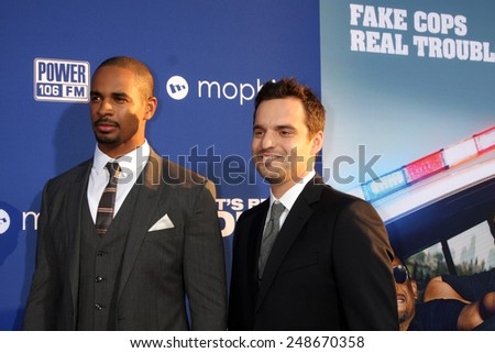 "LOS ANGELES - AUG 7:  Damon Wayans Jr, Jake Johnson at the ""Let's Be Cops"" Premiere at the ArcLight Hollywood Theaters on August 7, 2014 in Los Angeles, CA  - stock photo"