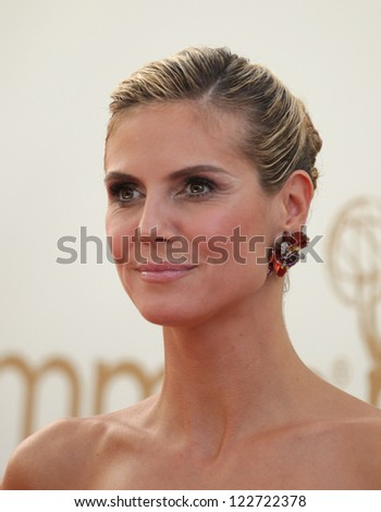 LOS ANGELES - AUG 11:  HEIDI KLUM arriving to Emmy Awards 2011  on August 11, 2012 in Los Angeles, CA - stock photo