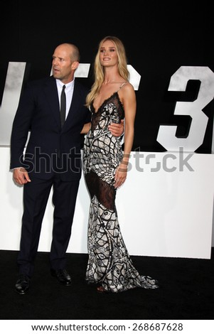 """LOS ANGELES - AUG 11:  Jason Statham, Rosie Huntington-Whiteley at the """"Expendables 3"""" Premiere at TCL Chinese Theater on August 11, 2014 in Los Angeles, CA - stock photo"""
