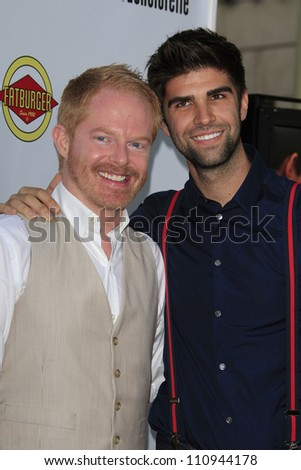 LOS ANGELES - AUG 23: Jesse Tyler Ferguson, Justin Mikita at the premiere of RADiUS-TWC's 'Bachelorette' at ArcLight Cinemas on August 23, 2012 in Los Angeles, California - stock photo