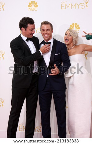 LOS ANGELES - AUG 25:  Jimmy Fallon, Derek Hough, Julianne Hough at the 2014 Primetime Emmy Awards - Arrivals at Nokia Theater at LA Live on August 25, 2014 in Los Angeles, CA - stock photo