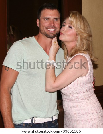 LOS ANGELES - AUG 26:  Joshua Morrow, Michelle Stafford attending the Young & Restless Fan Dinner 2011 at the Universal Sheraton Hotel on August 26, 2011 in Los Angeles, CA