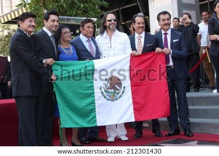 LOS ANGELES - AUG 21:  Los Tigres Del Norte, Consuelo Hernandez, Marco Antonio Solis at the Los Tigres Del Norte Honored On The Hollywood Walk Of Fame  on August 21, 2014 in Los Angeles, CA - stock photo