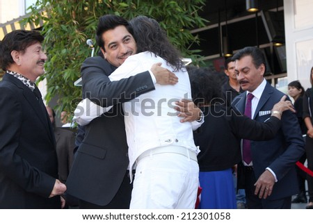 LOS ANGELES - AUG 21:  Los Tigres Del Norte, Marco Antonio Solis at the Los Tigres Del Norte Honored On The Hollywood Walk Of Fame at Live Nation Building on August 21, 2014 in Los Angeles, CA - stock photo