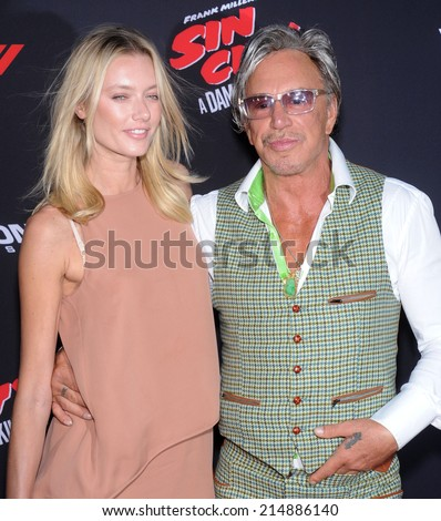 """LOS ANGELES - AUG 19:  Mickey Rourke arrives to the """"Sin City: A Dame To Kill For"""" Los Angeles Premiere  on August 19, 2014 in Hollywood, CA                 - stock photo"""