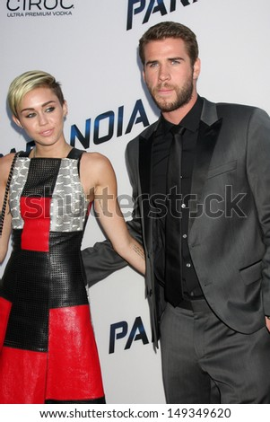 "LOS ANGELES - AUG 8:  Miley Cyrus, Liam Hemsworth arrives at the ""Paranoia"" Los Angeles Premiere at the Directors Guild of America on August 8, 2013 in Los Angeles, CA - stock photo"