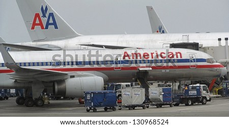 LOS ANGELES - AUG. 23: several American Airlines planes parked at LAX in Los Angeles on August 23, 2012. The recently announced merger with US Airways will bring a new logo for American Airlines jets. - stock photo