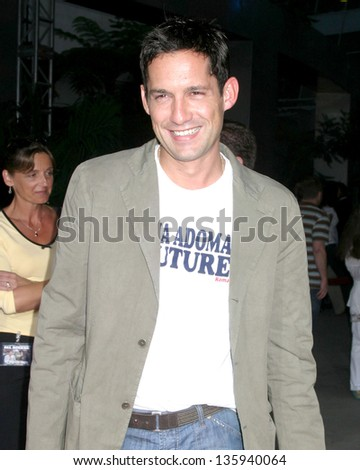 """LOS ANGELES - AUGUST 11: Enrique Murciano arriving at the """"40 Year Old Virgin"""" Premiere at Arc Light Theaters August 11, 2005 in Los Angeles, CA. - stock photo"""