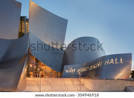 LOS ANGELES - AUGUST 9: Entrance of Walt Disney Concert Hall at twilight, CA August 9, 2015. The hall was designed by Frank Gehry and is a major component in the Los Angeles Music Center complex. - stock photo