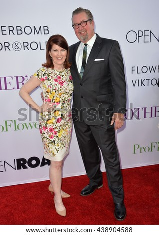 """LOS ANGELES, CA. April 13, 2016: Actress Kate Flannery & boyfriend Chris Haston at the world premiere of """"Mother's Day"""" at the TCL Chinese Theatre, Hollywood. - stock photo"""