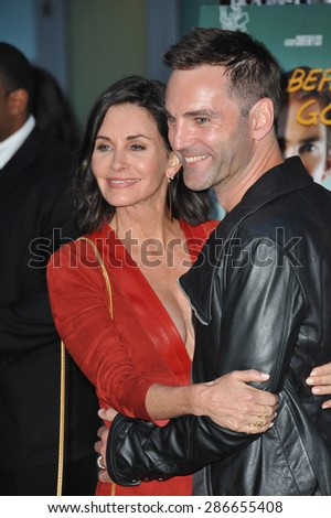 """LOS ANGELES, CA - APRIL 20, 2015: Courteney Cox & Johnny McDaid at the premiere of her movie """"Just Before I Go"""" at the Arclight Theatre, Hollywood.  - stock photo"""