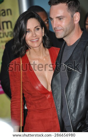 "LOS ANGELES, CA - APRIL 20, 2015: Courteney Cox & Johnny McDaid at the premiere of her movie ""Just Before I Go"" at the Arclight Theatre, Hollywood.  - stock photo"