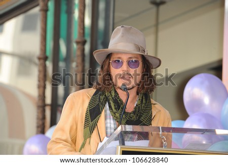 LOS ANGELES, CA - APRIL 1, 2011: Johnny Depp on Hollywood Boulevard where actress Penelope Cruz was honored with the 2,436th star on the Hollywood Walk of Fame. April 1, 2011  Los Angeles, CA - stock photo