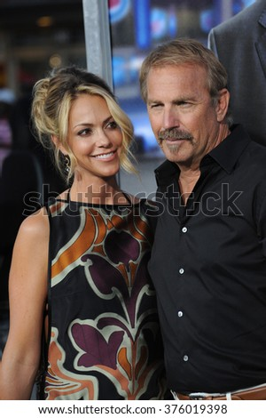 "LOS ANGELES, CA - APRIL 7, 2014: Kevin Costner & wife Christine Baumgartner at the Los Angeles premiere of his movie ""Draft Day"" at the Regency Village Theatre, Westwood."
