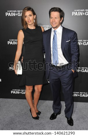 """LOS ANGELES, CA - APRIL 22, 2013: Mark Wahlberg & wife Rhea Durham at the Los Angeles premiere of his movie """"Pain & Gain"""" at the Chinese Theatre, Hollywood.  - stock photo"""