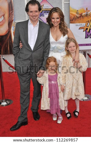 "LOS ANGELES, CA - APRIL 2, 2009: Melora Hardin & husband & daughters at the world premiere of her new movie ""Hannah Montana The Movie"" at the El Capitan Theatre, Hollywood."