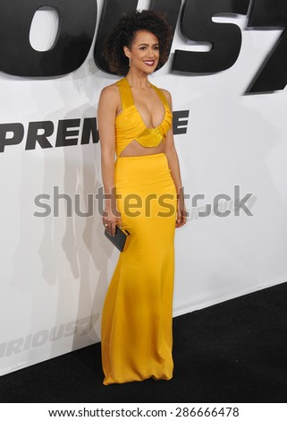 """LOS ANGELES, CA - APRIL 1, 2015: Nathalie Emmanuel at the world premiere of her movie """"Furious 7"""" at the TCL Chinese Theatre, Hollywood. April 1, 2015  Los Angeles, CA  - stock photo"""
