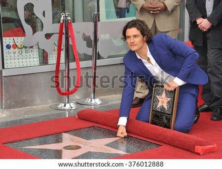 LOS ANGELES, CA - APRIL 2, 2014: Orlando Bloom on Hollywood Blvd where he was honored with the 2,521st star on the Hollywood Walk of Fame. - stock photo