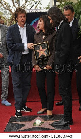 LOS ANGELES, CA - APRIL 14, 2009: Paul McCartney & Olivia Harrison & son Dhani Harrison at Hollywood Walk of Fame star ceremony honoring the late George Harrison.