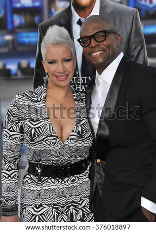 "LOS ANGELES, CA - APRIL 7, 2014: Terry Crews & wife at the Los Angeles premiere of his movie ""Draft Day"" at the Regency Village Theatre, Westwood."