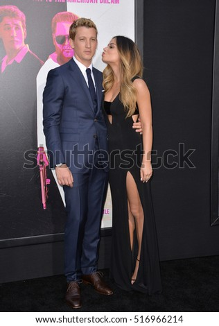 "LOS ANGELES, CA. August 15, 2016: Actor Miles Teller & girlfriend model Keleigh Sperry at the Los Angeles premiere of ""War Dogs"" at the TCL Chinese Theatre, Hollywood."