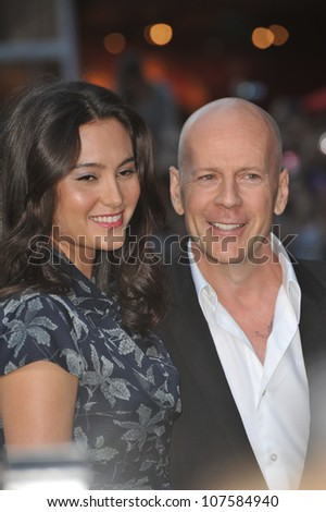 """LOS ANGELES, CA - AUGUST 3, 2010: Bruce Willis & wife Emma Heming at the world premiere of his new movie """"The Expendables"""" at Grauman's Chinese Theatre, Hollywood. - stock photo"""