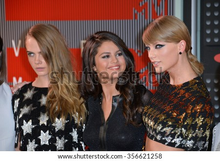 LOS ANGELES, CA - AUGUST 30, 2015: Cara Delevingne, Selena Gomez & Taylor Swift at the 2015 MTV Video Music Awards at the Microsoft Theatre LA Live.