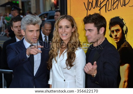"LOS ANGELES, CA - AUGUST 20, 2015: Director/co-writer Max Joseph (left) & actor Zac Efron with screenwriter Meaghan Oppenheimer at the premiere of ""We Are Your Friends"" at the TCL Chinese Theatre"