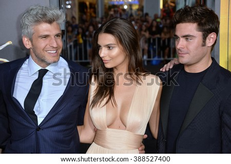 "LOS ANGELES, CA - AUGUST 20, 2015: Emily Ratajkowski & Zac Efron with director/co-writer Max Joseph (left) at the Los Angeles premiere of their movie ""We Are Your Friends"" - stock photo"