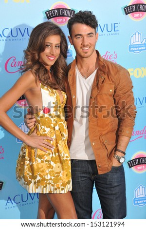 LOS ANGELES, CA - AUGUST 11, 2013: Joe Jonas & date at the 2013 Teen Choice Awards at the Gibson Amphitheatre, Universal City, Hollywood.  - stock photo