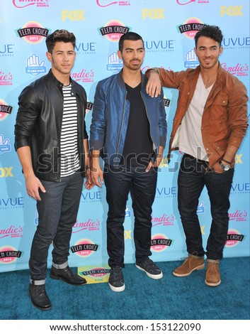 LOS ANGELES, CA - AUGUST 11, 2013: Jonas Brothers - Nick Jonas, Kevin Jonas & Joe Jonas - at the 2013 Teen Choice Awards at the Gibson Amphitheatre, Universal City, Hollywood.  - stock photo