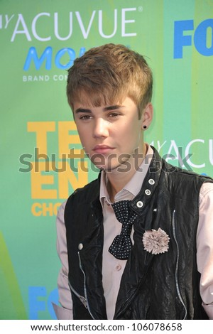 LOS ANGELES, CA - AUGUST 7, 2011: Justin Bieber arrives at the 2011 Teen Choice Awards at the Gibson Amphitheatre, Universal Studios, Hollywood. August 7, 2011  Los Angeles, CA - stock photo
