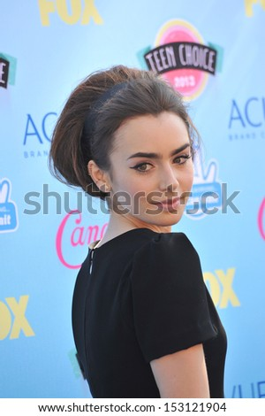 LOS ANGELES, CA - AUGUST 11, 2013: Lily Collins at the 2013 Teen Choice Awards at the Gibson Amphitheatre, Universal City, Hollywood.  - stock photo
