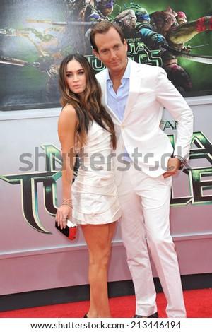 "LOS ANGELES, CA - AUGUST 3, 2014: Megan Fox & Will Arnett at the premiere of their movie ""Teenage Mutant Ninja Turtles"" at the Regency Village Theatre, Westwood.  - stock photo"